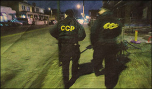 Picture of Community Crime Patrollers working. Photo courtesy of www.dispatch.com.